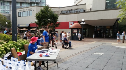 Julie Wittig, LWVJC Voter Registration Coordinator registering voters on the Ped Mall, downtown Iowa City