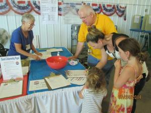 Syndy Conger registering voters at the 2014 Johnson County Fair